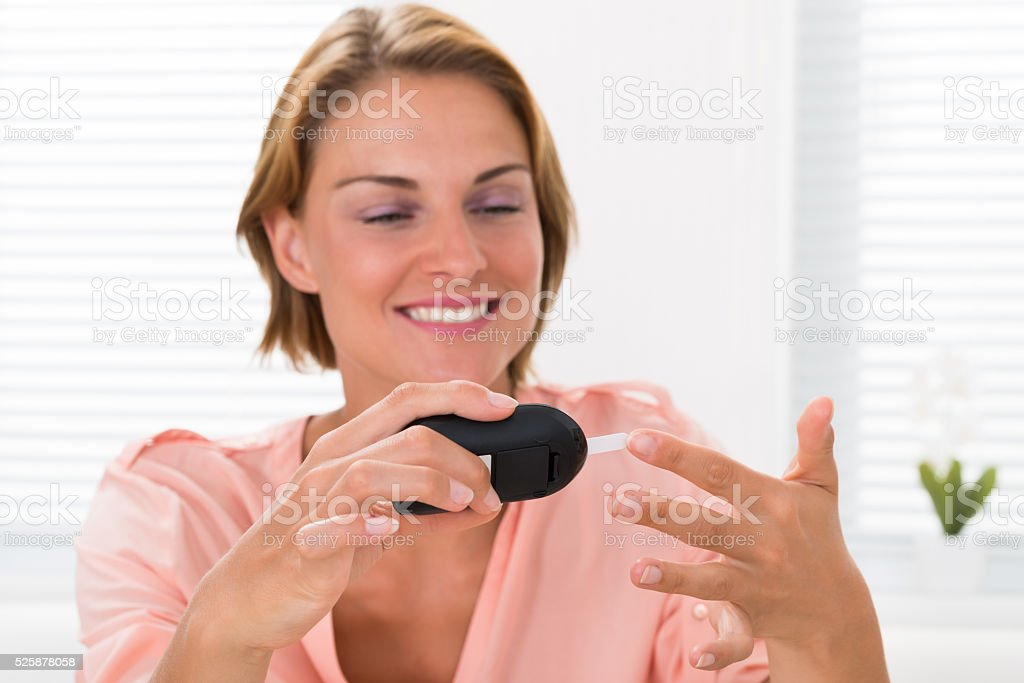 Woman Checking Glucose Level stock photo