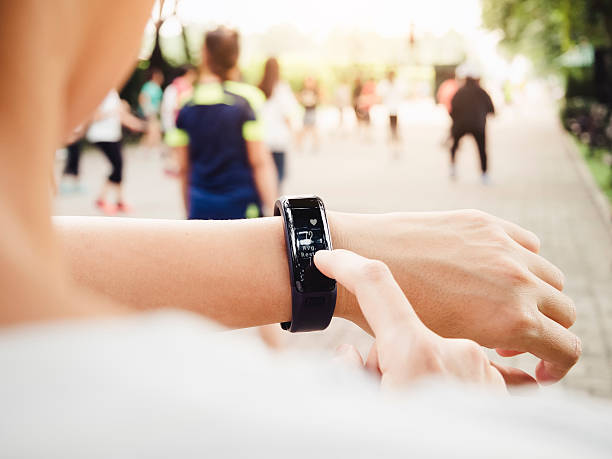 Woman checking Heart rate Exercise Workout fitness Smart watch stock photo