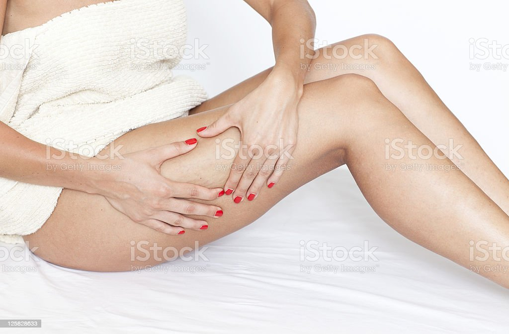 Woman checking her legs for cellulite stock photo