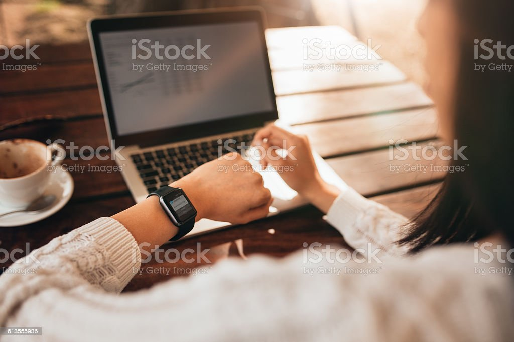 Woman checking her smartwatch stock photo