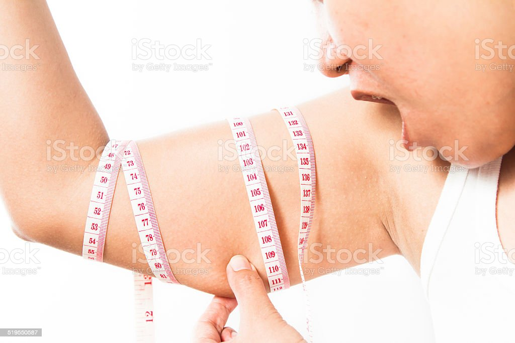 woman checking her upper arm stock photo