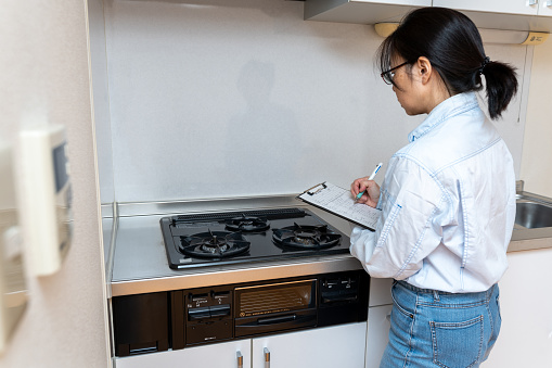 Woman checking house equipment