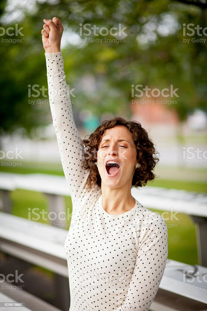 Woman Cheering At The Park stock photo