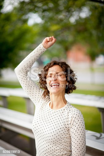 istock Woman Cheering At The Park 525919913
