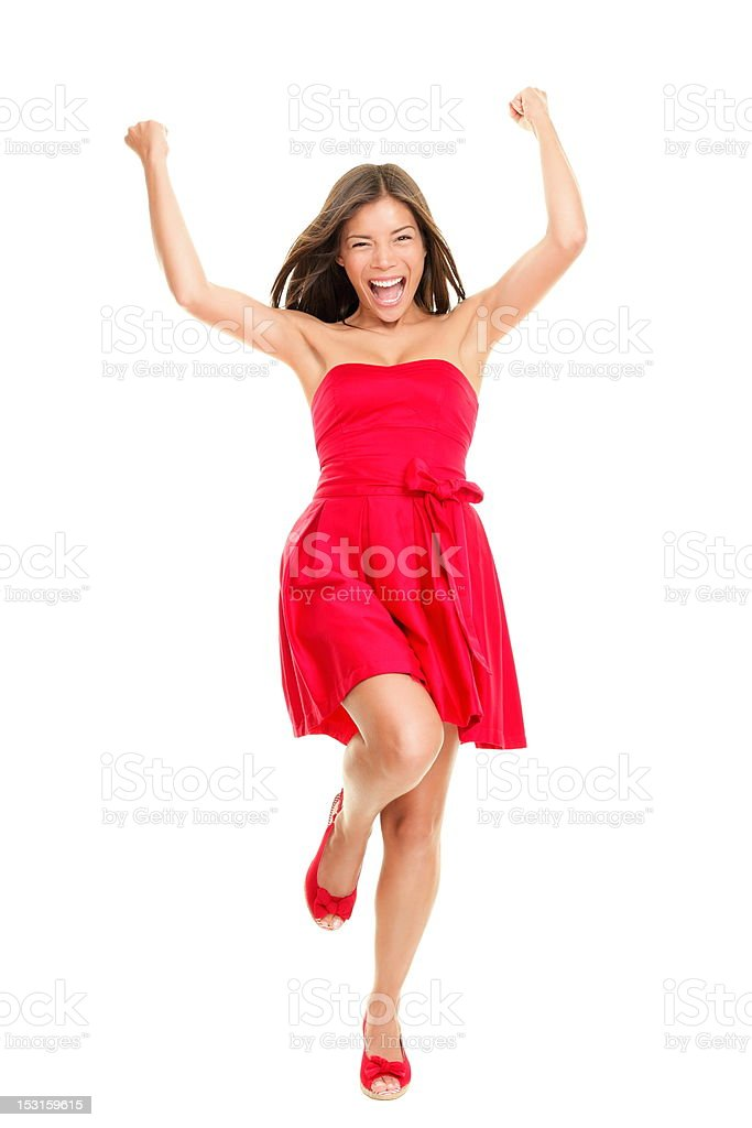 Woman cheering in summer dress Woman happy cheering in summer dress - playful and cheerful. Isolated on white background in full length. Beautiful fresh young mixed race ethnic female model in red dress. 20-24 Years Stock Photo