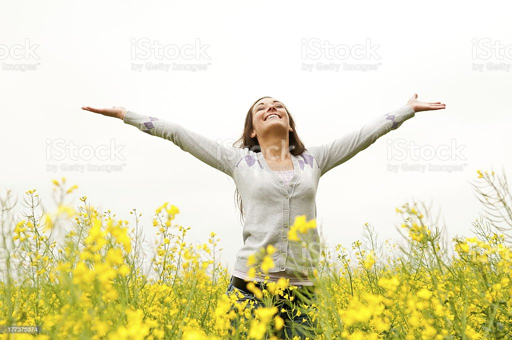 woman cheering in the rape field stock photo