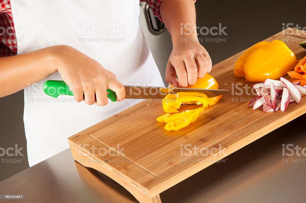 woman chef cutting pepper royalty-free stock photo