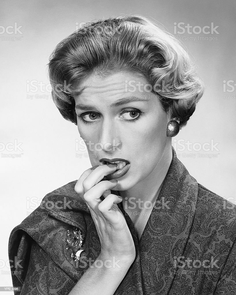 Woman chewing nails royalty-free stock photo