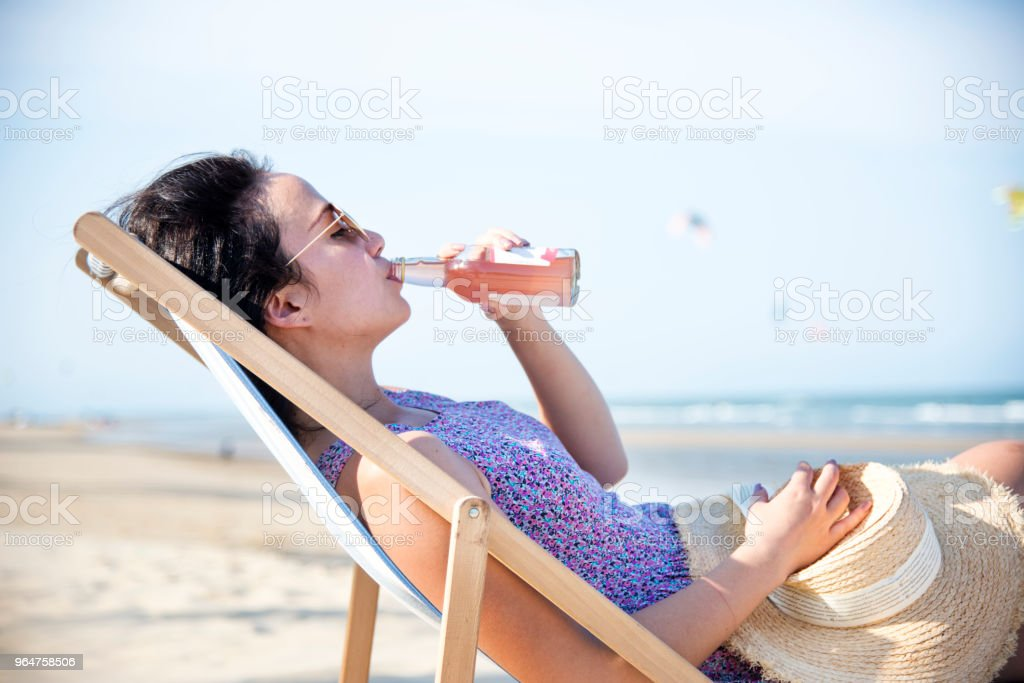 Woman chilling on the beach royalty-free stock photo