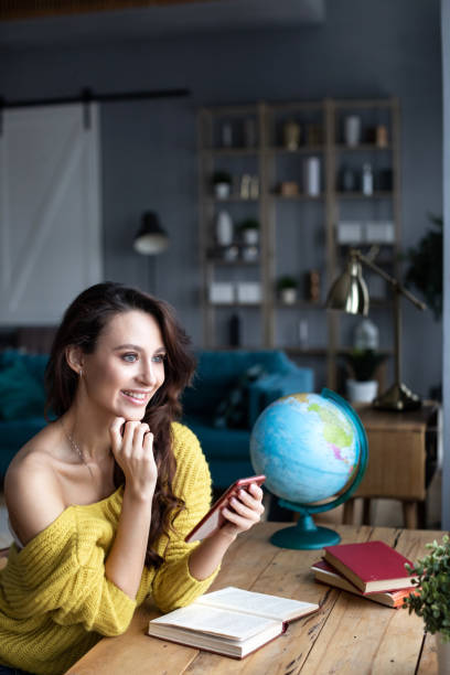 Woman choose a place to travel. stock photo