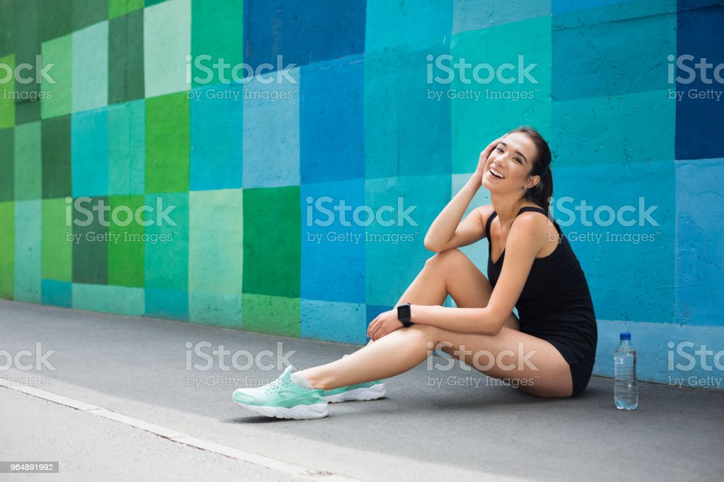 Woman choose music to listen during workout royalty-free stock photo