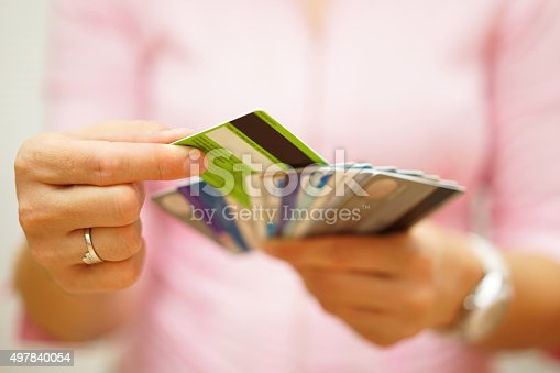 istock woman choose one credit card, concept of  credit  debt 497840054