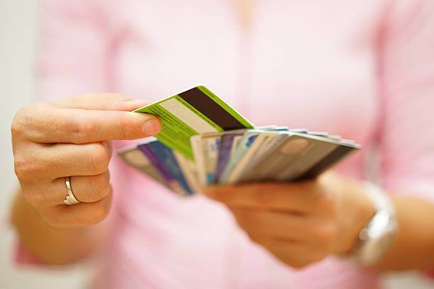 woman choose one credit card, concept of  credit  debt stock photo