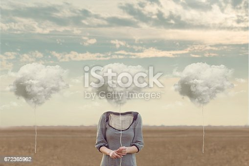istock woman chooses her cloud to hide his face 672365962
