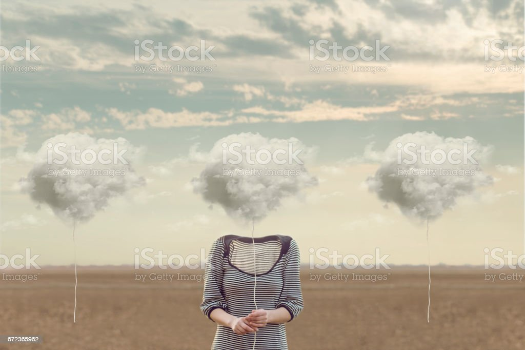 woman chooses her cloud to hide his face stock photo