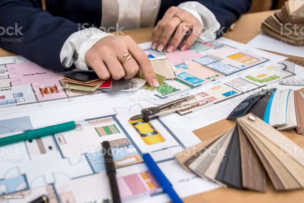 Woman chooses materials with color palette for home project stock photo