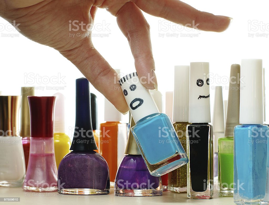 Woman chooses the nail lacquer from collection royalty-free stock photo