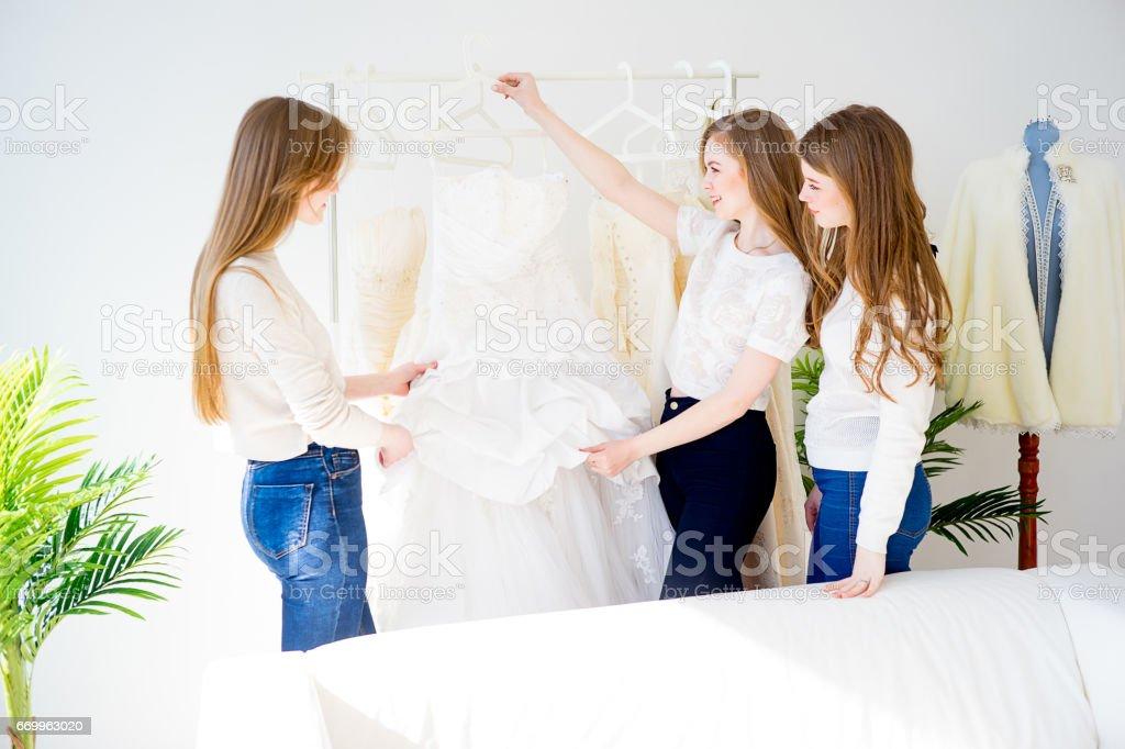 Woman choosing a wedding dress stock photo