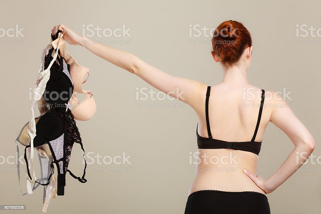 woman choosing bras to wear stock photo
