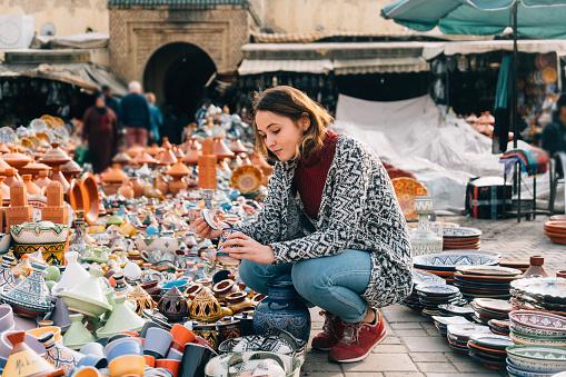 Woman choosing Ceramic  in shop in Meknes, Morocco