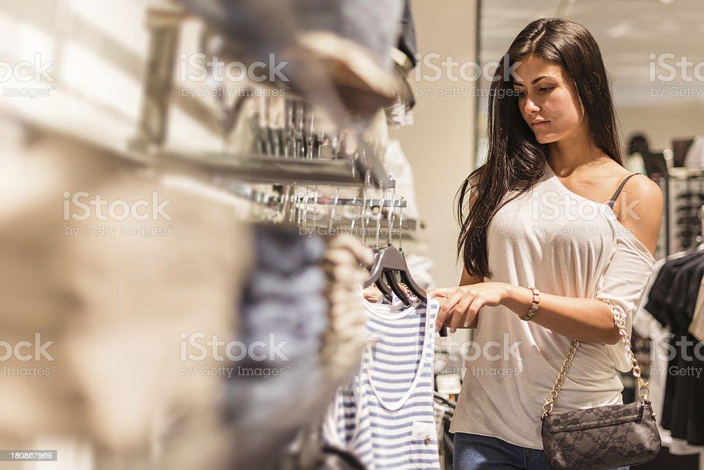 woman choosing clothes at store royalty-free stock photo