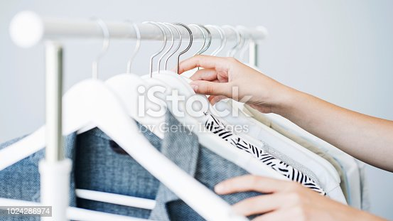 istock Woman choosing clothes on a rack 1024286974