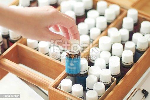 istock Woman choosing essential oil 918391802