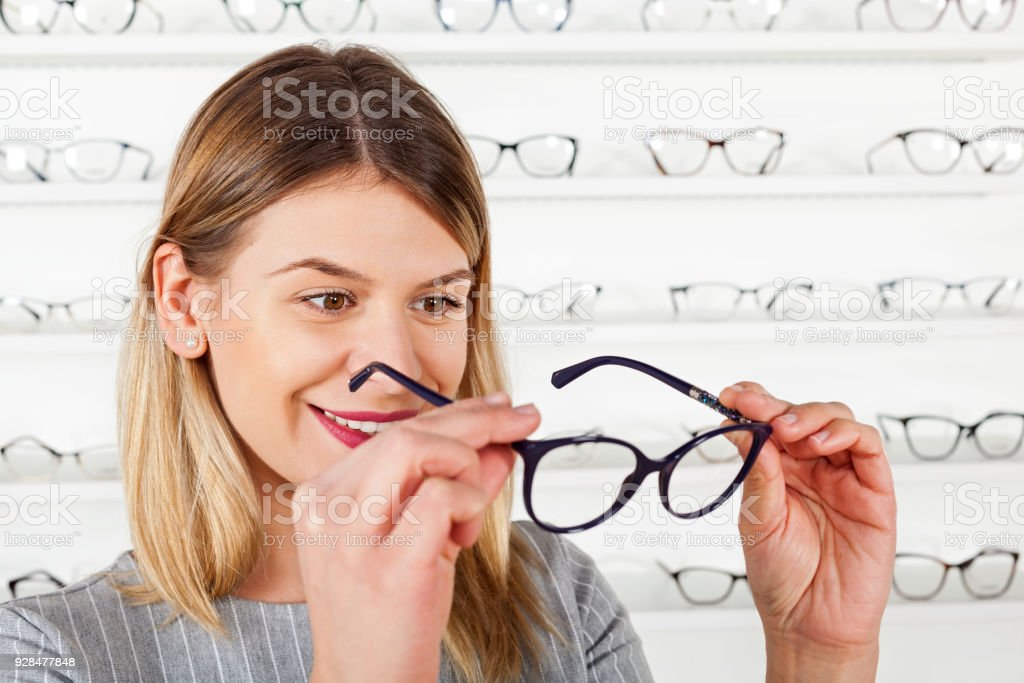 Woman Choosing Eyeglass Frame Stock Photo & More Pictures of Adult ...