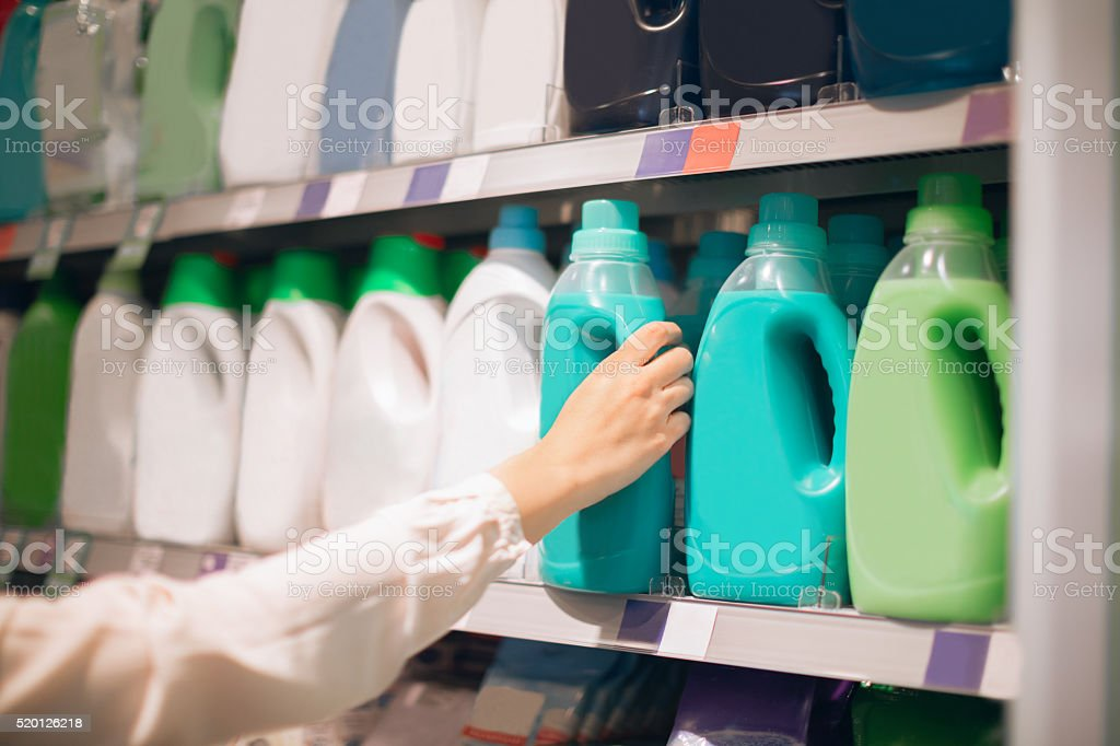 Woman choosing fabric softener stock photo