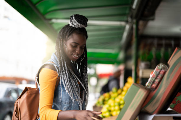 Woman choosing fruits on feira stock photo