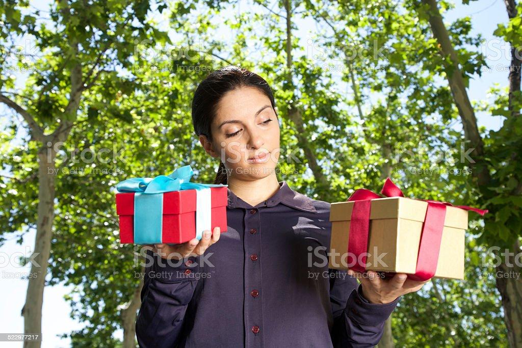 woman choosing gift stock photo