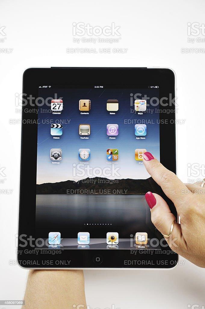 Woman Choosing iTunes On Her Apple iPad royalty-free stock photo