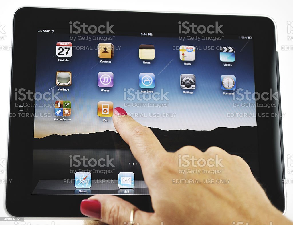 Woman Choosing Itunes On Her Apple Ipad Stock Photo