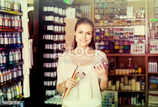 594918592 istock photo woman choosing paint color in tube 583732636