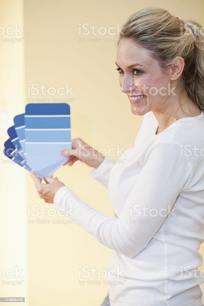Woman choosing paint color stock photo