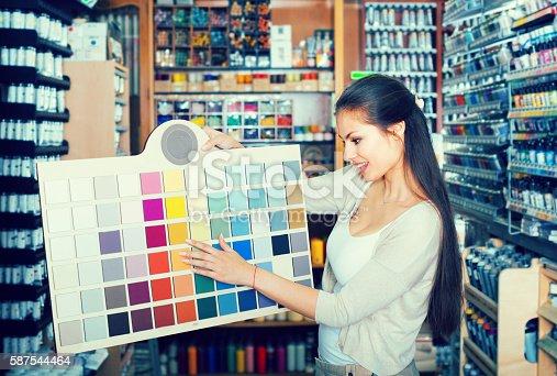 istock woman choosing paint color 587544464