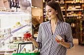 Woman choosing red caviar at fish supermarket