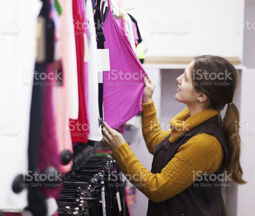 woman choosing shirt at clothing store royalty-free stock photo