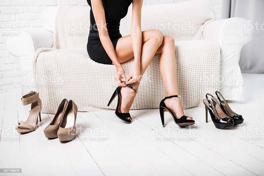 Woman choosing shoes stock photo