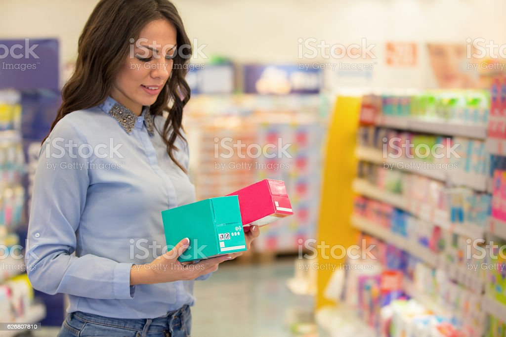 Woman choosing tampons stock photo