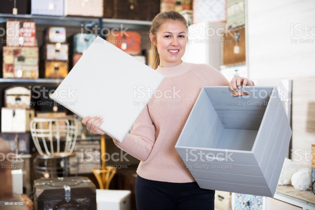Woman choosing wooden box royalty-free stock photo