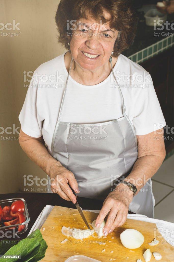 Woman chopping onion stock photo