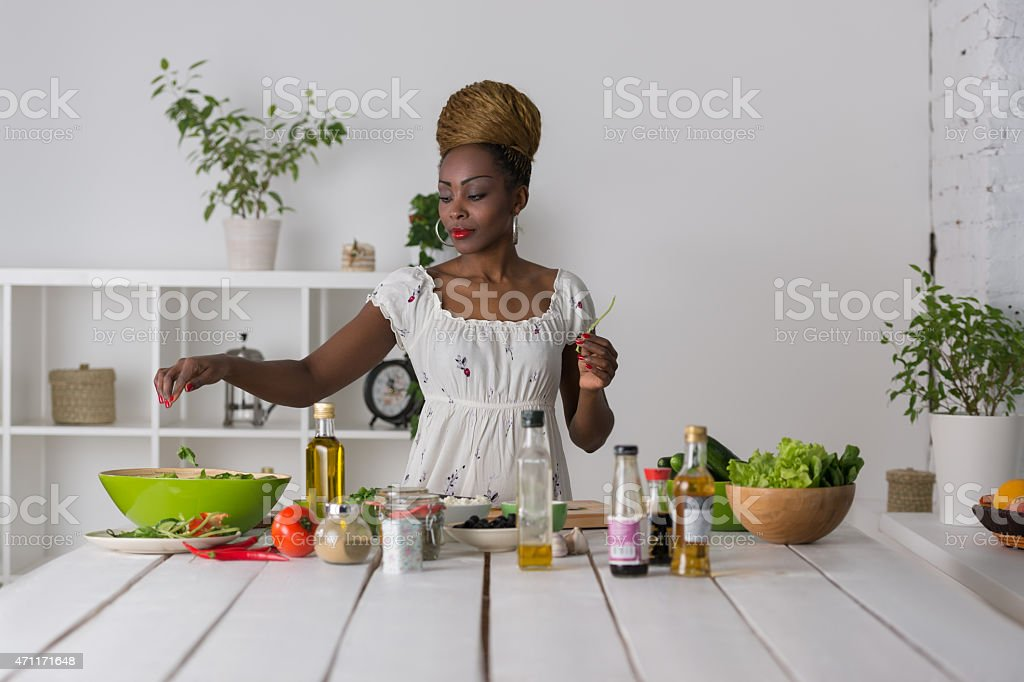 Woman chopping vegetables for salad stock photo