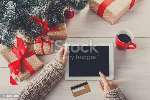 istock Woman christmas shopping online with a credit card 624054180
