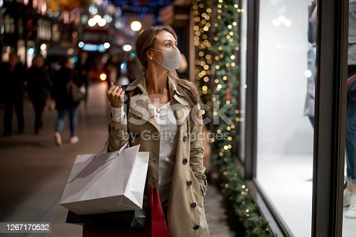 istock Woman Christmas shopping wearing a facemask 1267170532