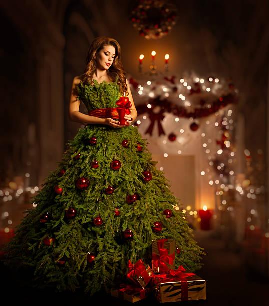 woman christmas tree dress, fashion model in xmas gown - kleid mit verzierung stock-fotos und bilder