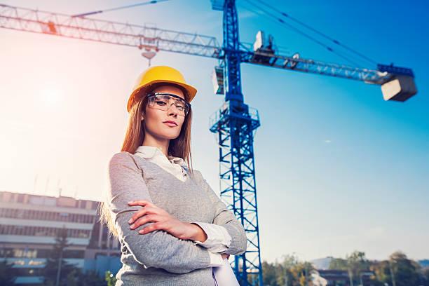 woman civil engineer or architect - arquitecta fotografías e imágenes de stock