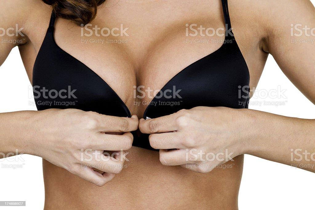 Mujer clasping bra - foto de stock