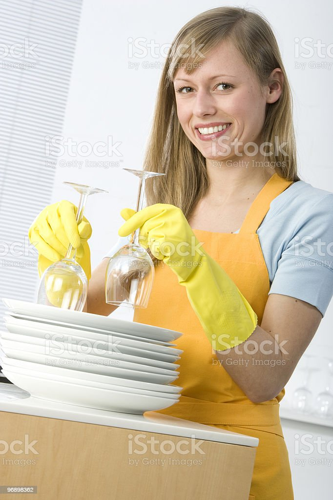 Woman cleaning dishes royalty-free stock photo