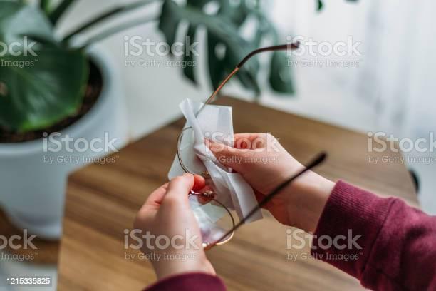 Woman cleaning eyeglasses picture id1215335825?b=1&k=6&m=1215335825&s=612x612&h=gospdstnlx6b5ezie2jwrz6ujvpxgzvw0ecrpkruzyk=
